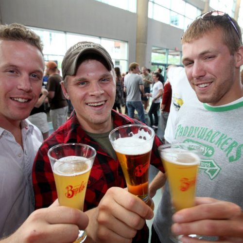 Friends, from left, toast at Buffalo Brew Fest at the HSBC Arena on August 6, 2010.  They are Tony Eberlie of Newcastle, Australia, Chris Craine, of North Tonawanda and Ryan Feickert of Buffalo. {Photo by Robert Kirkham}